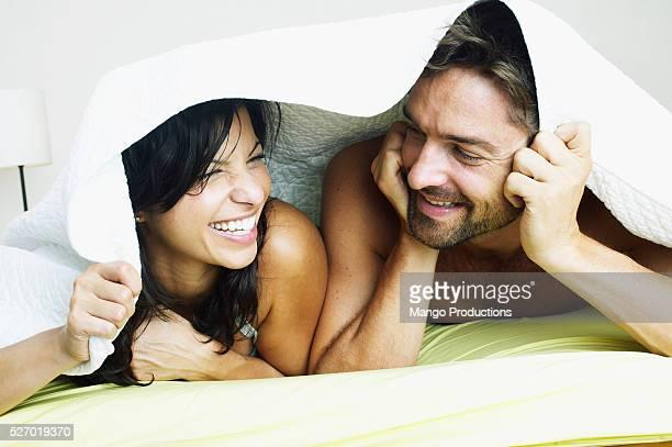 Happy Couple Under Blanket