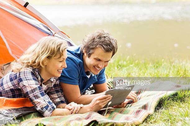 Happy Couple Using Digital Tablet