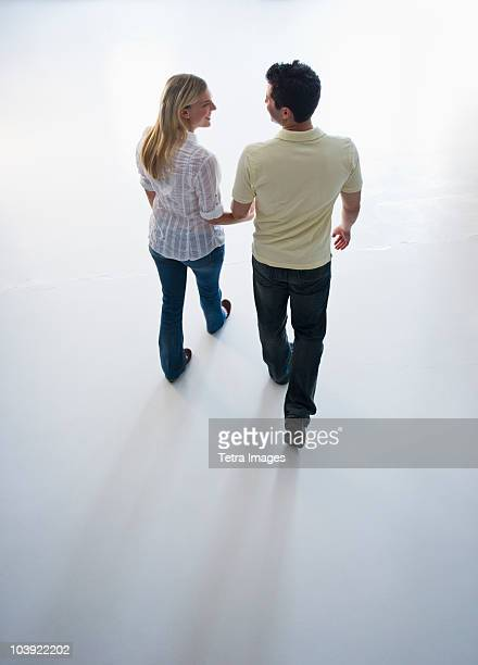 Happy couple walking hand in hand