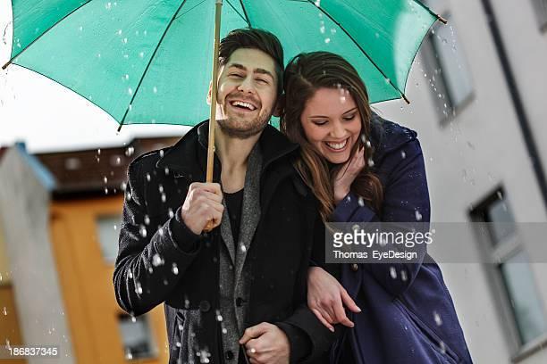 Happy Couple Walking in the Rain