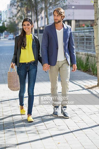 Happy couple walking on a street