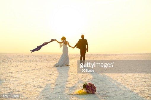 Happy couple walking on snow