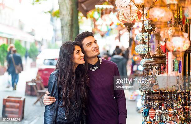 Happy Couple Window Shopping in a Street Bazaar