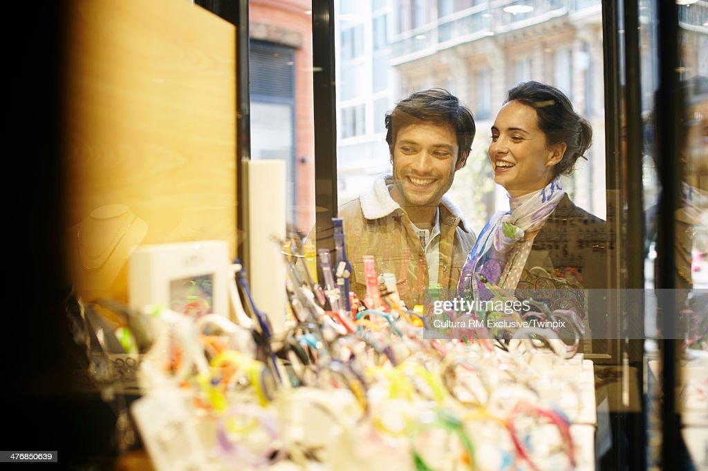 Happy couple window shopping : Stock Photo