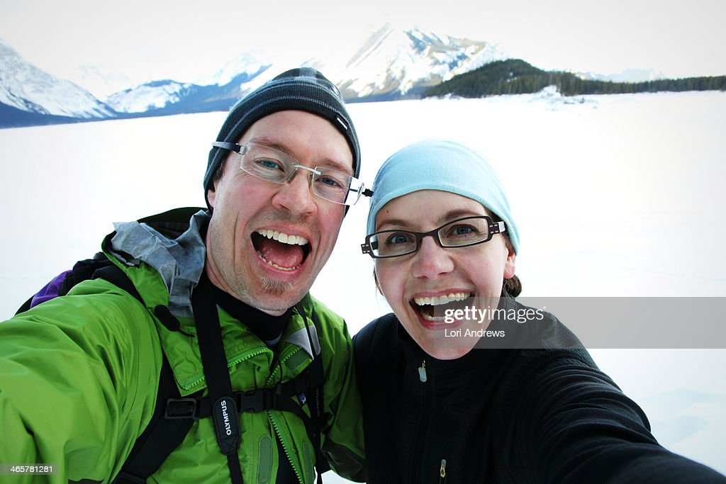 Happy Couple with Big Smiles in snowy mountains : Stock Photo