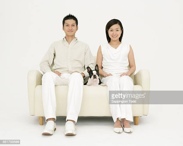 Happy Couple With Boston Terrier