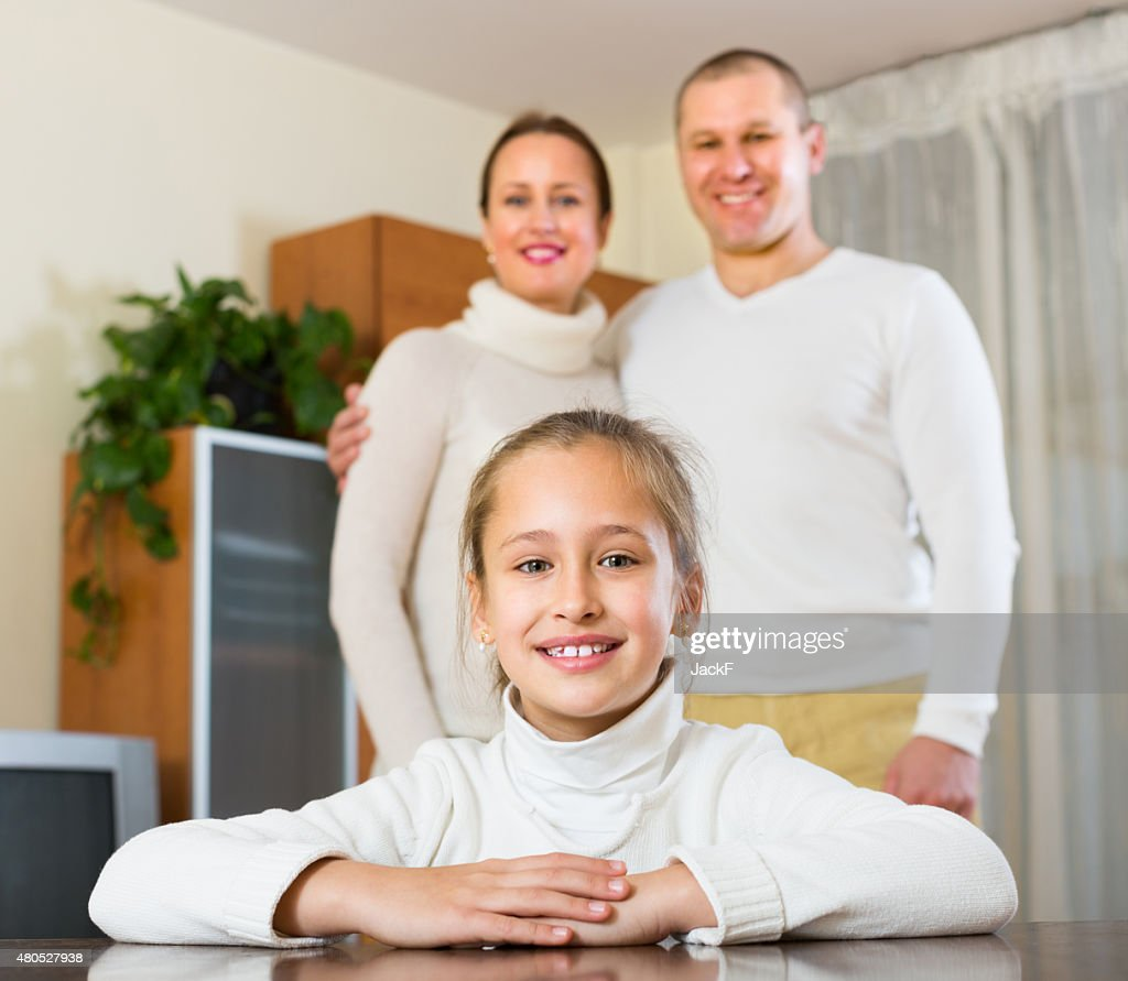 Happy couple with daughter at home : Stock Photo