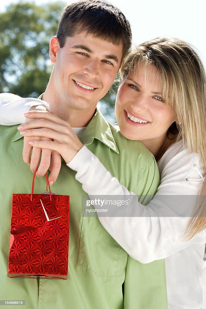 happy couple with gift : Stock Photo