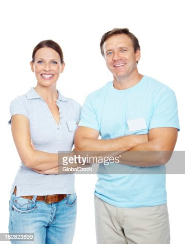 Happy couple with hands crossed against white background