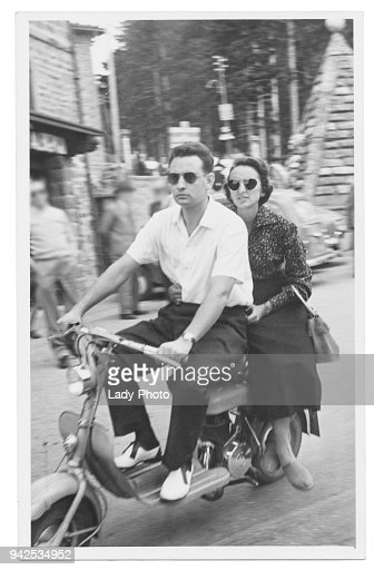 Happy couple with motorcycle in 1950 : Foto stock