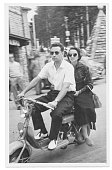 Happy couple with motorcycle in 1950
