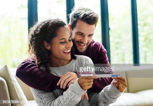 Happy couple with pregnancy news : Stock Photo