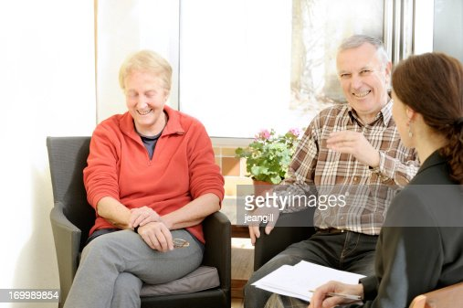 Happy couple with professional worker : Stock Photo