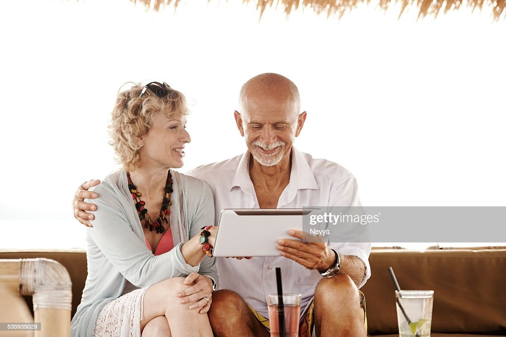 Happy couple with tablet : Stock Photo