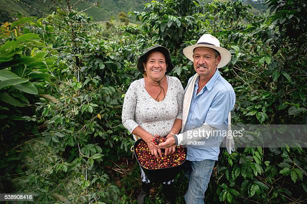 Happy couple working at a coffee farm