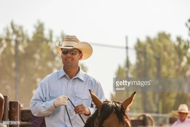 Happy cowboy on a horse