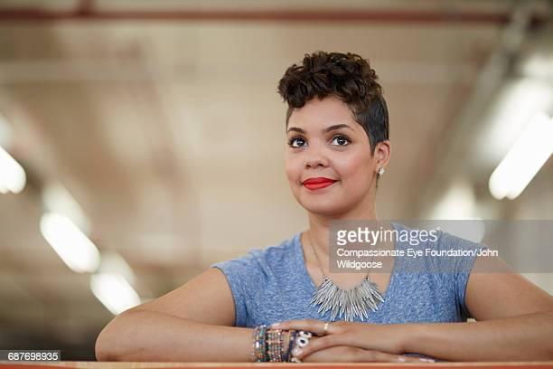 Happy creative businesswoman in office