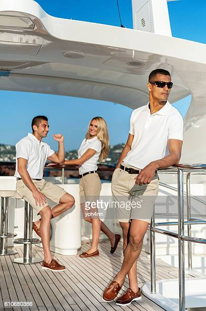 Happy crew members on luxury yacht