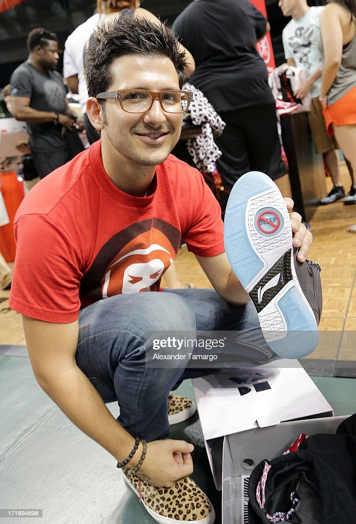 A happy customer shows off his limited edition pair of Dwyane Wade Li-Ning 'Team No Sleep' sneakers at SneakerCon at Bank United Center on June 29, 2013 in Miami, Florida.
