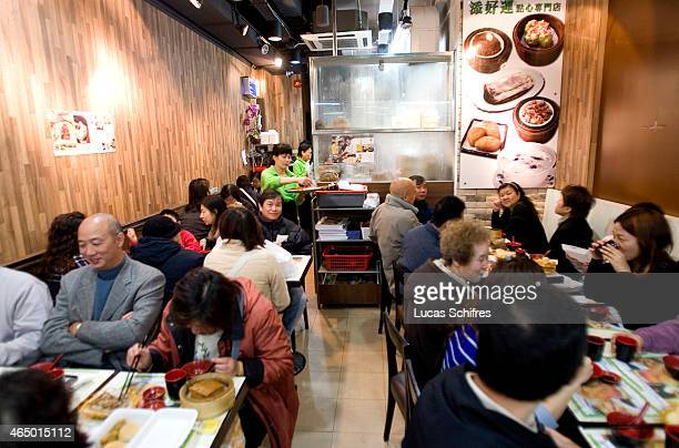 Happy customers eat at Tim Ho Wan 32seat restaurant on December 18 2009 in Hong Kong China Tim Ho Wan restaurant is the world's cheapest Michelin...