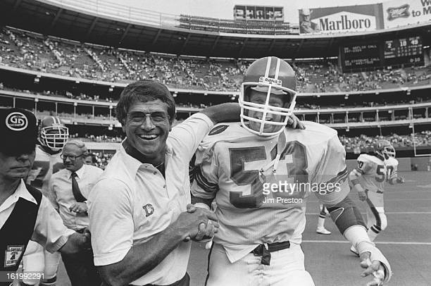 SEP 5 1983 A happy Dan Reeves gives a handshake and a hug to defensive star Randy Gradishar Sunday following the Denver Broncos' 1410 victory over...