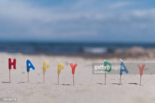 'Happy day' written with colorful letters at beach