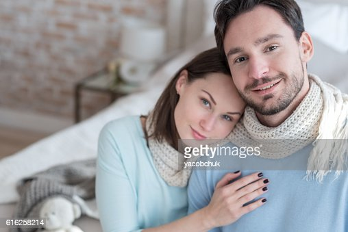 Happy delighted man sitting near his girlfriend : Stock Photo