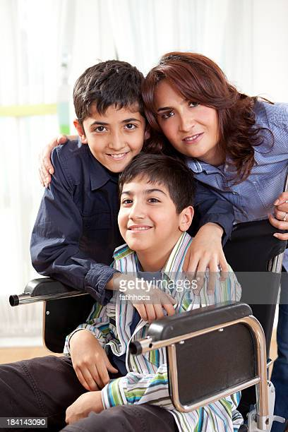 Happy Disabled Little Boy and His Family