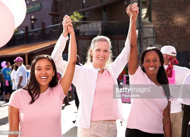 Happy Diverse Group of Women In Pink Celebrating Victory