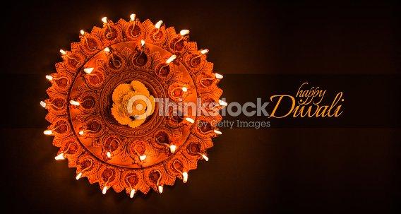Happy diwali greeting card design using beautiful clay diya lamps happy diwali greeting card design using beautiful clay diya lamps lit on diwali night celebration m4hsunfo