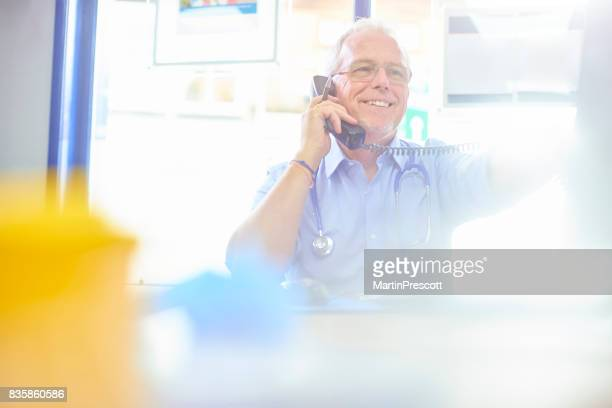 Happy doctor calling up for test results