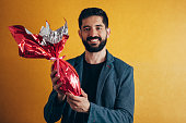Happy Easter. Happy man holding chocolate easter egg
