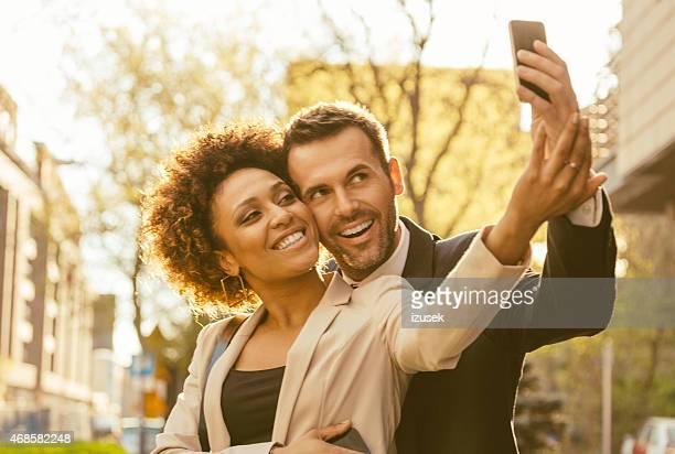 Happy elegance adult couple talking selfie outdoor
