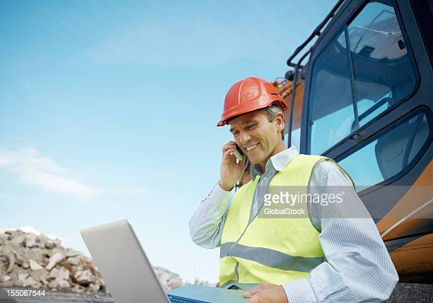 Happy engineer working at construction site