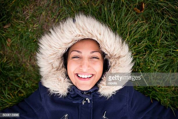 Happy eskimo girl on the ground,laughing