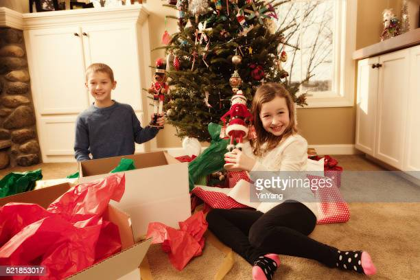 Happy Excited Children Opening Christmas Presents in Front of Tree-2