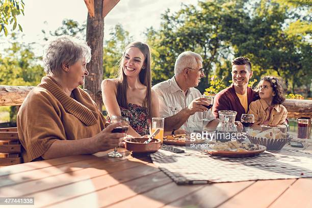 Happy extended family communicating during a lunch in a restaurant.