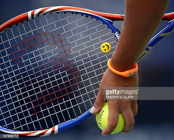 A Happy Face String Dampener is seen on the racquet of Sara Errani from Italy as she plays against Samantha Stosur from Australia during their US...