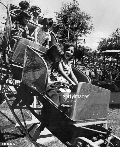 Happy Faces Reflect Enjoyment of Festival Children on the midget roller coaster enjoy a ride in the kiddies section of Lakeside Amusement Park Sunday...