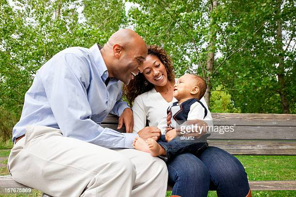 Happy Family African American playing with their baby boy