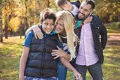 Mixed-race family enjoying in public park