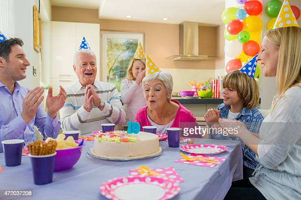 Happy family at a grandmothers birthday party