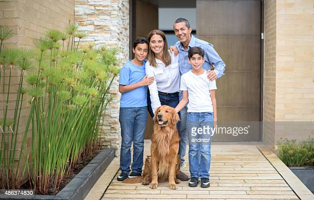 Happy family at home with their dog