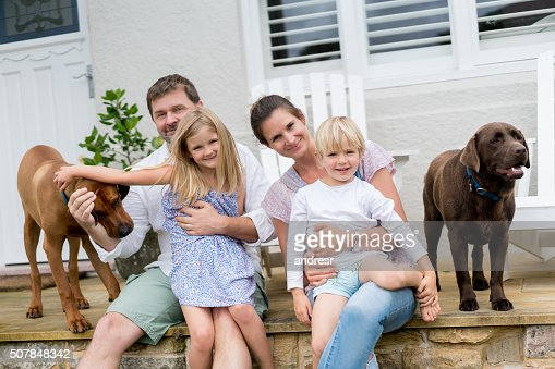 Happy family at home with their dogs