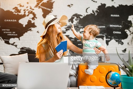 Happy family at the travel agency office : Stock Photo