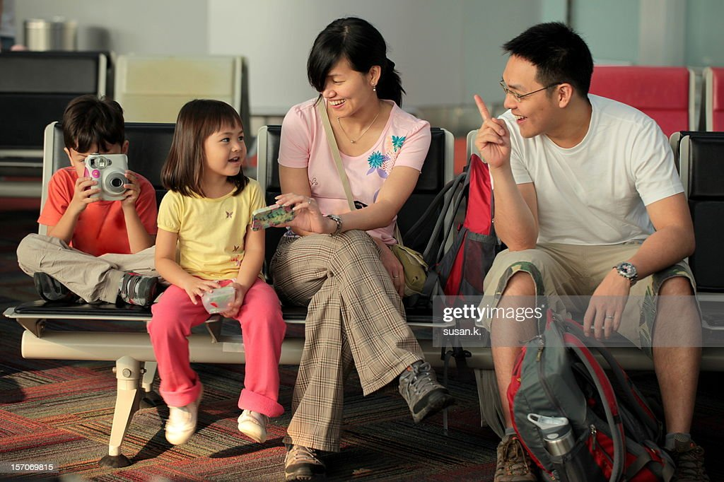 Happy family at waiting lounge. : Stock Photo