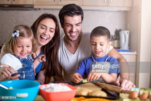 Happy family baking cookies