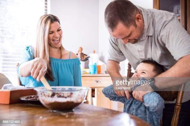 Happy family baking for birthday