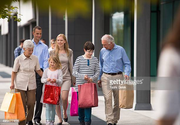 Happy Family carrying shopping bags