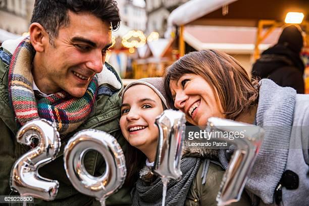 Happy family celebrate New Year's Eve